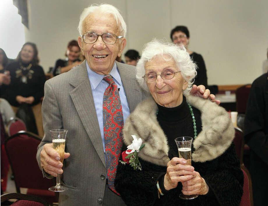 AP file photo / BK AngelettiJohn and Ann Betar, of Fairfield, celebrate their 80th anniversary at St. Nicholas Antiochian Orthodox Church in Bridgeport on Nov. 25, 2012. / The Connecticut Post