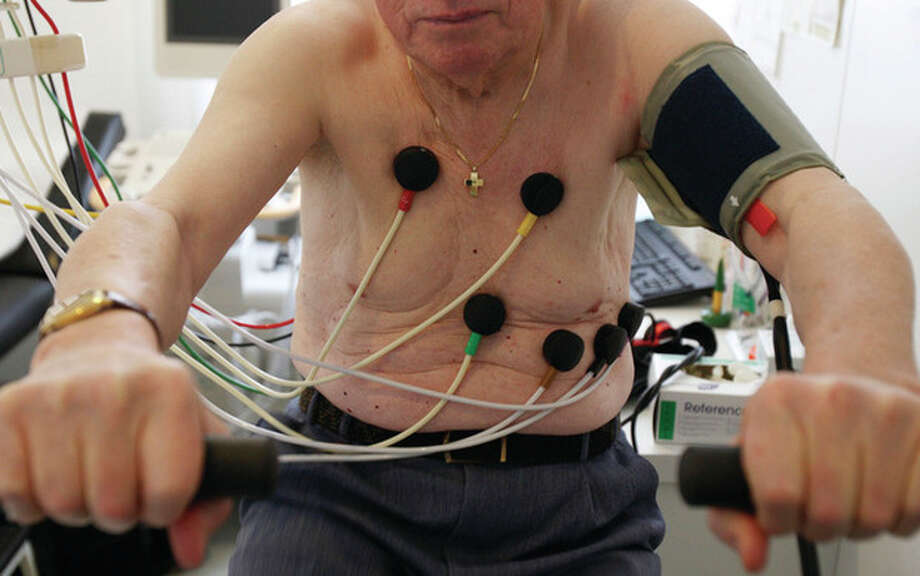 AP file photo In this Feb. 6, 2009, file photo, a man sits on an ergometer during an electrocardiogram in a doctor's surgical office in Stuttgart, Germany. / AP2009