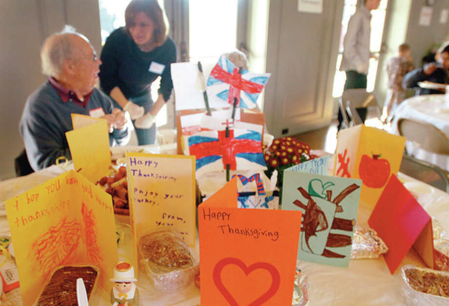 Tables were decorated for the Saugatuck Congregational Church Thanksgiving Feast Thursday with cards made by students of Coleytown Elementary School. Hour photo / Erik Trautmann / (C)2011, The Hour Newspapers, all rights reserved