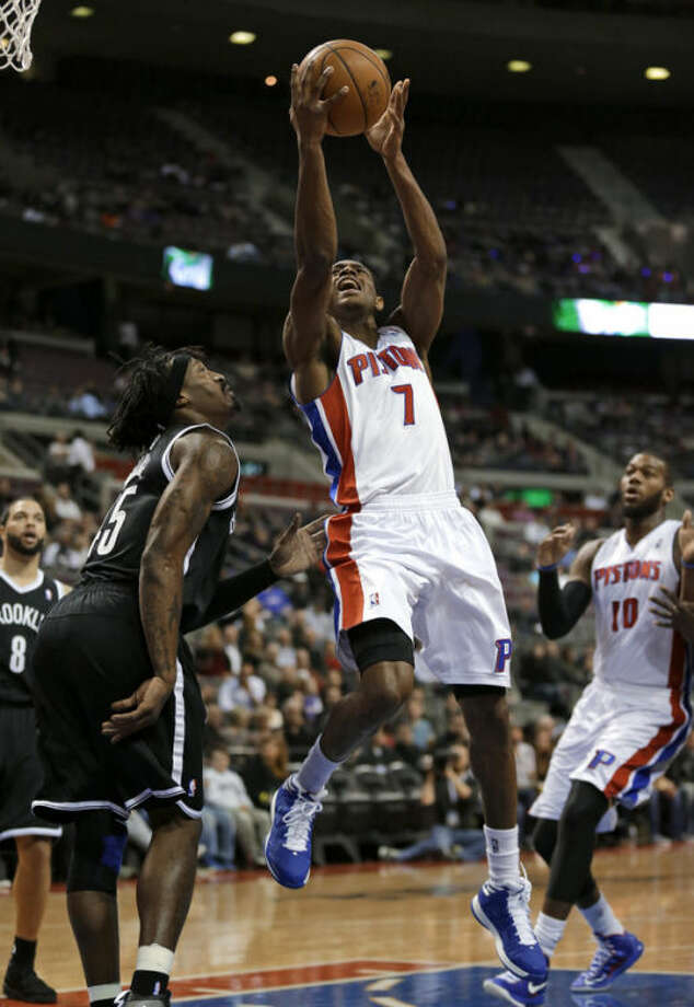Detroit Pistons guard Brandon Knight (7) drives against Brooklyn Nets forward Gerald Wallace (45) during the first half of an NBA basketball game in Auburn Hills, Wednesday, Feb. 6, 2013. (AP Photo/Paul Sancya)