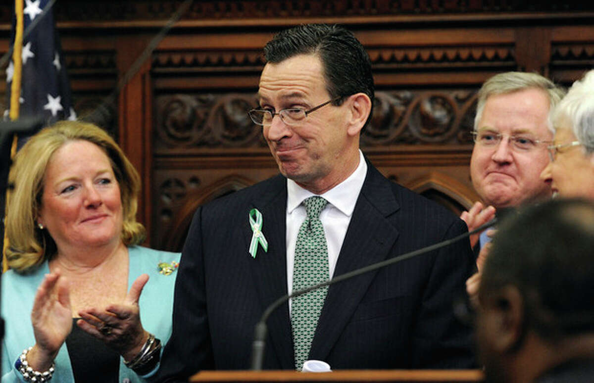 Connecticut Gov. Dannel P. Malloy reacts after outlining his budget proposals for the next fiscal year during a noon joint session of the General Assembly at the Capitol in Hartford, Conn., Wednesday, Feb. 6, 2013. Malloy unveiled the second, two-year budget of his administration on Wednesday, promising to move Connecticut closer to recovery from the national recession by continuing investments in education and job development. (AP Photo/Jessica Hill)