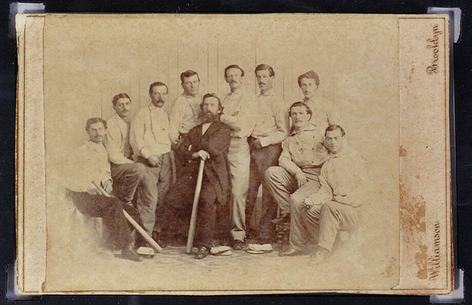 FILE - This undated file photo released Wednesday, Jan. 9, 2013 by the Saco River Auction Co., in Biddeford, Maine, shows a rare 1865 baseball card of the Brooklyn Atlantics, discovered in a photo album bought at a yard sale in Baileyville, Maine, on the Canadian border. The auction house expects six-figure bids at its Feb. 6 auction. (AP Photo/ Saco River Auction Co., File) / Saco River Auction Co.