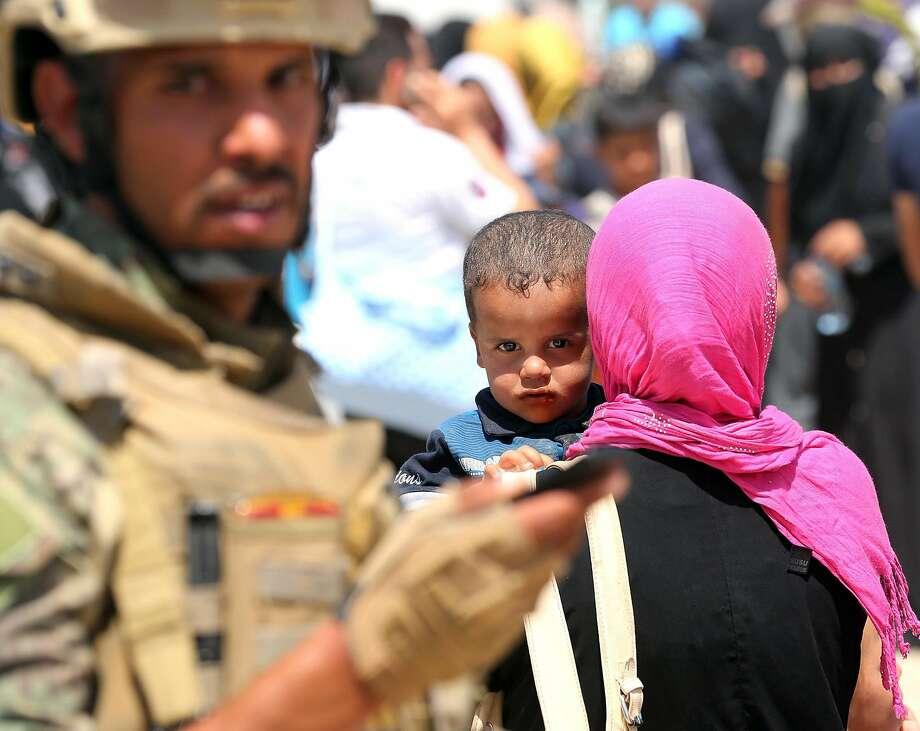 Internally displaced Iraqis at a camp outside Fallujah, Photo: Hadi Mizban, Associated Press