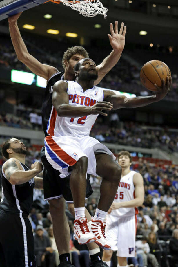 Detroit Pistons point guard Will Bynum (12) drives on Brooklyn Nets center Brook Lopez during the first half of an NBA basketball game in Auburn Hills, Mich., Wednesday, Feb. 6, 2013. (AP Photo/Paul Sancya)