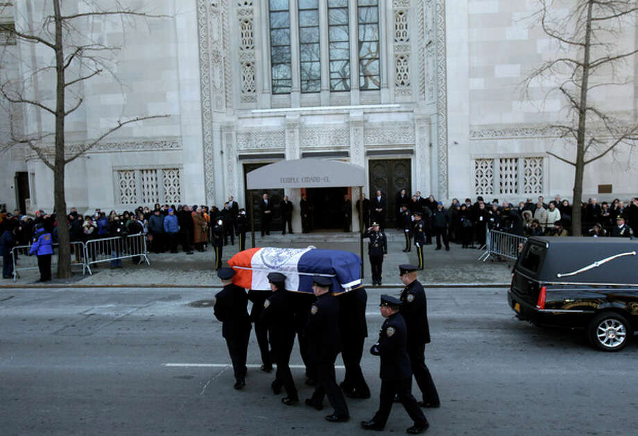 The casket containing the body of former New York City Mayor Ed Koch is brought into a synagogue for his funeral in New York, Monday, Feb. 4, 2013. Koch died Friday of congestive heart failure at age 88. (AP Photo/Seth Wenig) / AP