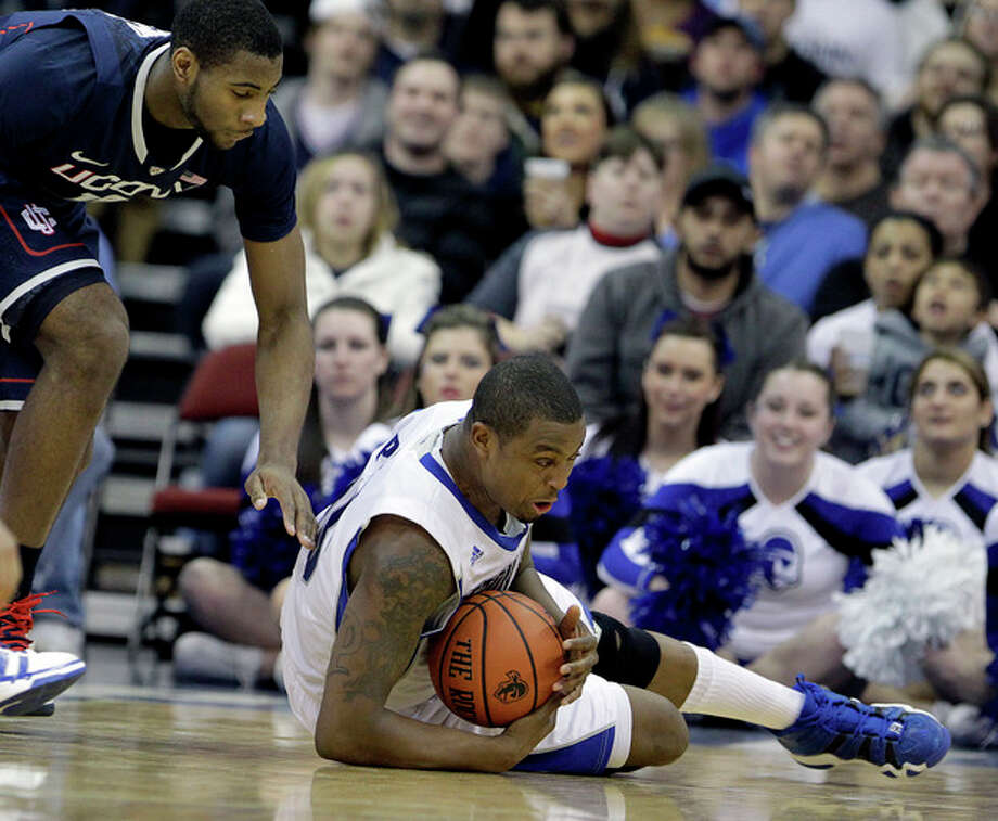 Seton Hall forward Herb Pope, right, dives for the ball as Connecticut center Andre Drummond, left, reaches in the first half of an NCAA college basketball game, Tuesday, Jan. 3, 2012, in Newark, N.J. (AP Photo/Julio Cortez) / AP