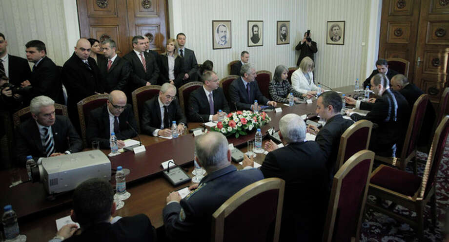 Bulgarian officials attend the Consultative Council meeting on National Security at the Bulgarian President's office in Sofia, Tuesday, Feb. 5, 2013. Investigators are releasing a summary of their findings to the Bulgarian government Tuesday, which is widely expected to link the militant group Hezbollah to the bus bomb attack on July 18, 2012, that killed five Israeli tourists in the coastal city of Burgas, Bulgaria. (AP Photo/Valentina Petrova) / AP