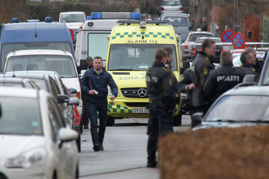 Danish police attend the crime scene after a shooting incident, Tuesday, Feb. 5, 2013, in Copenhagen, Denmark. The Danish writer and prominent Islam critic, Lars Hedegaard, survived an attempted assassination Tuesday at his home in Copenhagen, the advocacy group Danish Free Press Society, that he heads said Tuesday. No injuries are reported. (AP Photo/Jens Dresling, POLFOTO) DENMARK OUT / POLFOTO
