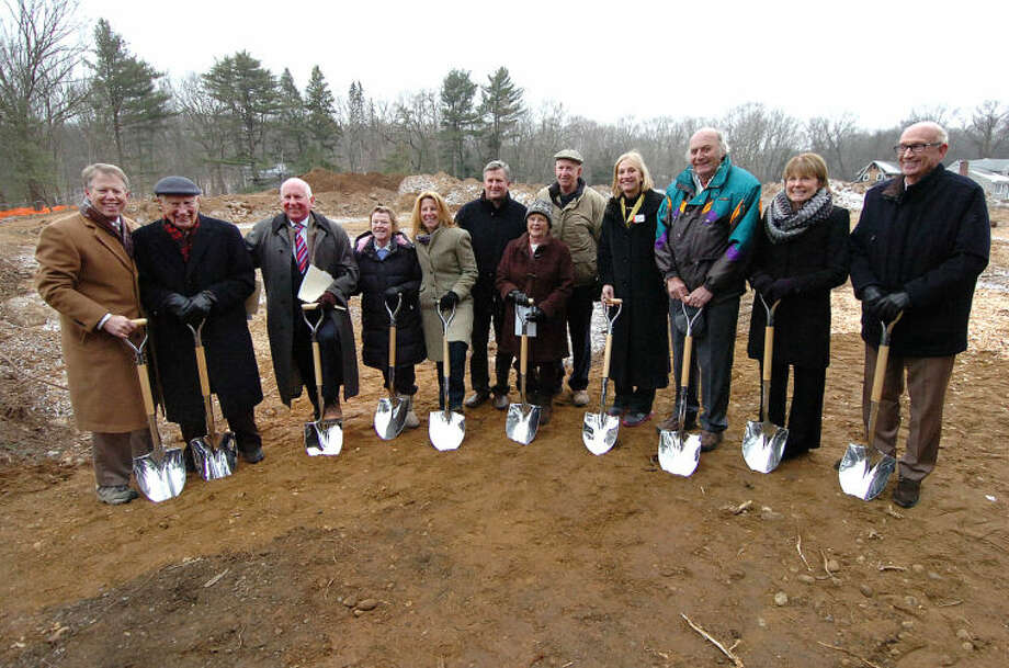 Hour Photo Alex von Kleydorff; People line up with shovels for a groundbreaking ceremony at the new YMCA site in Westport