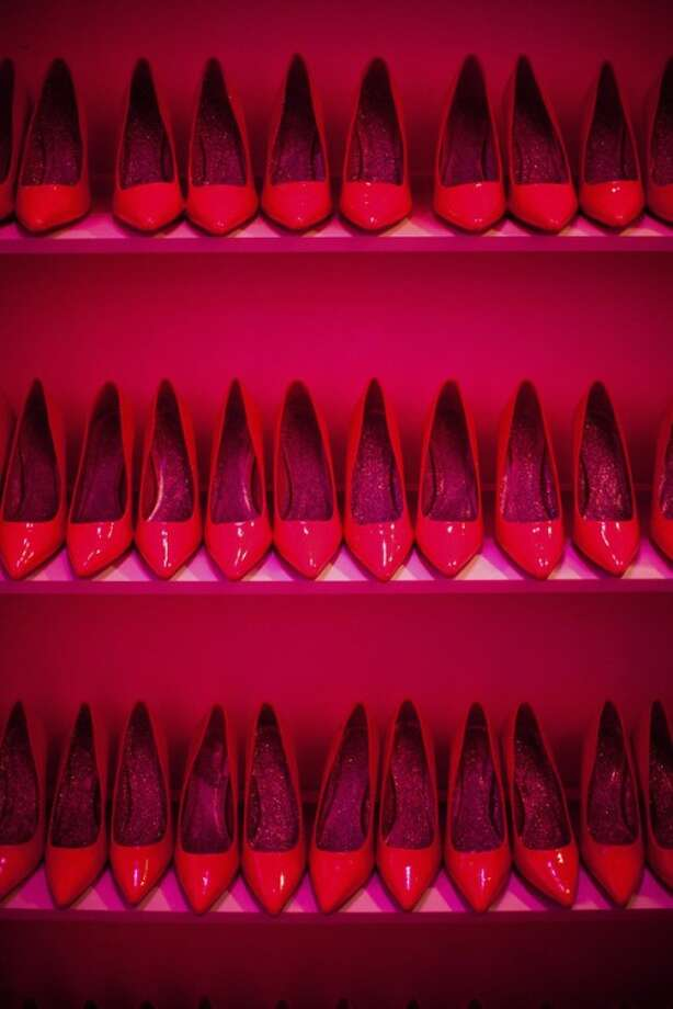 Rows of shoes line a wall at the Barbie Dream House party during Fashion Week in New York, Friday, Feb. 10, 2012. (AP Photo/John Minchillo)