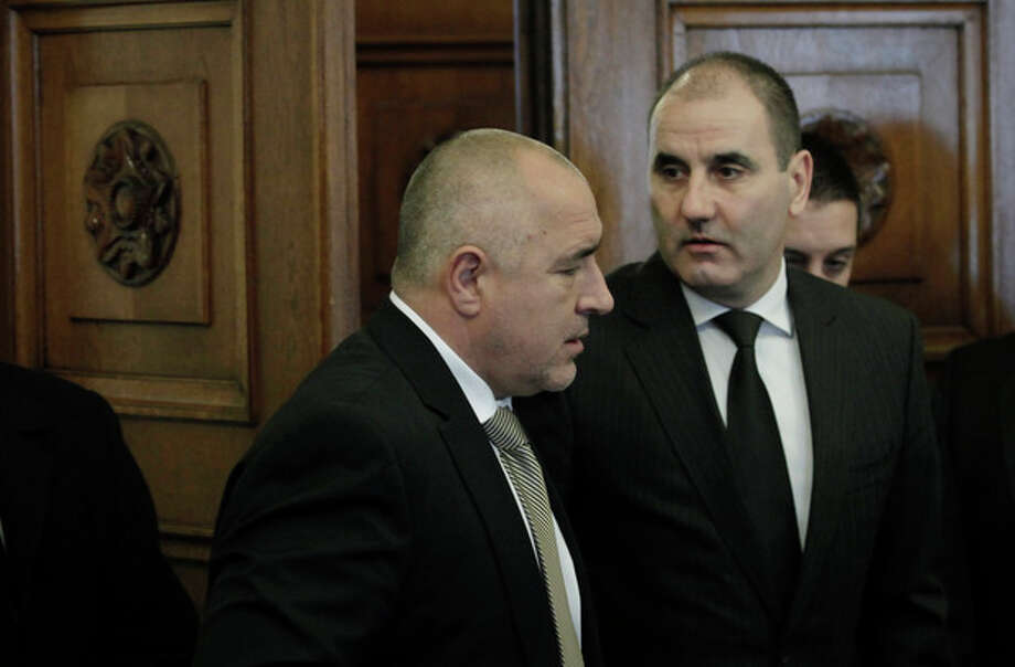 Bulgarian Prime Minister Boyko Borissov, left, and Bulgarian Interior Minister Tsvetan Tsvetanov, right, enter the Consultative Council meeting on National Security at the Bulgarian President's office in Sofia, Tuesday, Feb. 5, 2013. Investigators are releasing a summary of their findings to the Bulgarian government Tuesday which is widely expected to link the militant group Hezbollah to the bus bomb attack on July 18, 2012, that killed five Israeli tourists in the coastal city of Burgas, Bulgaria. (AP Photo/Valentina Petrova) / AP