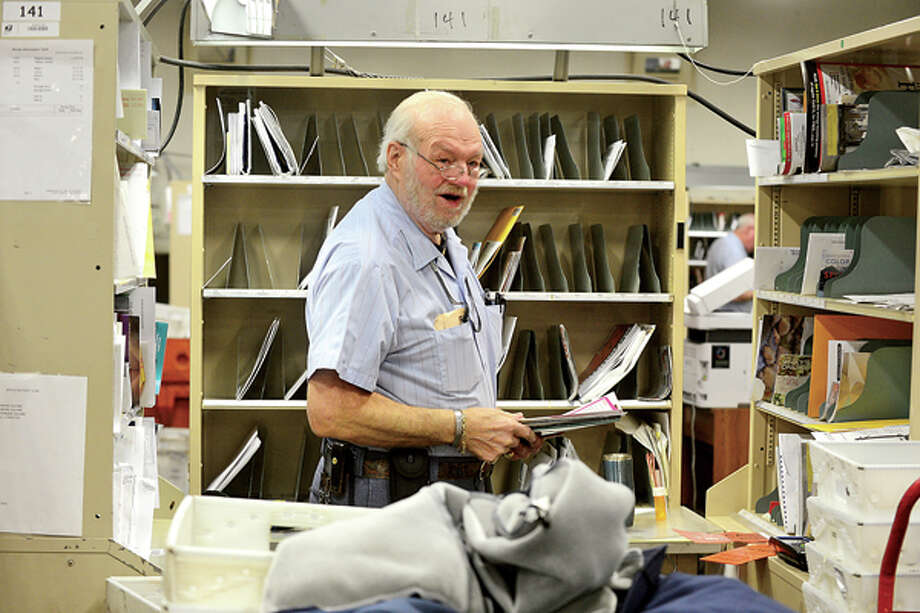 Stamford Letter Carrier, Jerry Fortin, celebrates 50 years on the route with the Postal Service. Hour photo / Erik Trautmann / (C)2012, The Hour Newspapers, all rights reserved