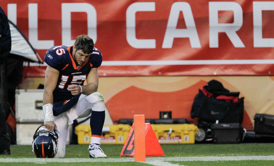 Denver Broncos quarterback Tim Tebow (15) kneels on the sidelines during the third quarter of an NFL wild card playoff football game against the Pittsburgh Steelers, Sunday, Jan. 8, 2012, in Denver. (AP Photo/Joe Mahoney) / Copyright 2012 The Associated Press. All rights reserved. This material may not be published, broadcast, rewritten or redistributed.