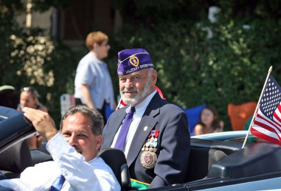 Grand Marshal Phil Marzolf rides in a car driven by Andy Garfunkel in Norwalk''s annual Memorial Day parade Monday morning. Hour Photo / Danielle Robinson