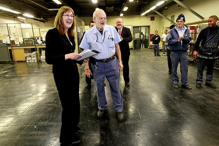 District Manager Kimberly Peters holds a recognition ceremony for Stamford Letter Carrier, Jerry Fortin, for 50 years on the route with the Postal Service. Hour photo / Erik Trautmann / (C)2012, The Hour Newspapers, all rights reserved
