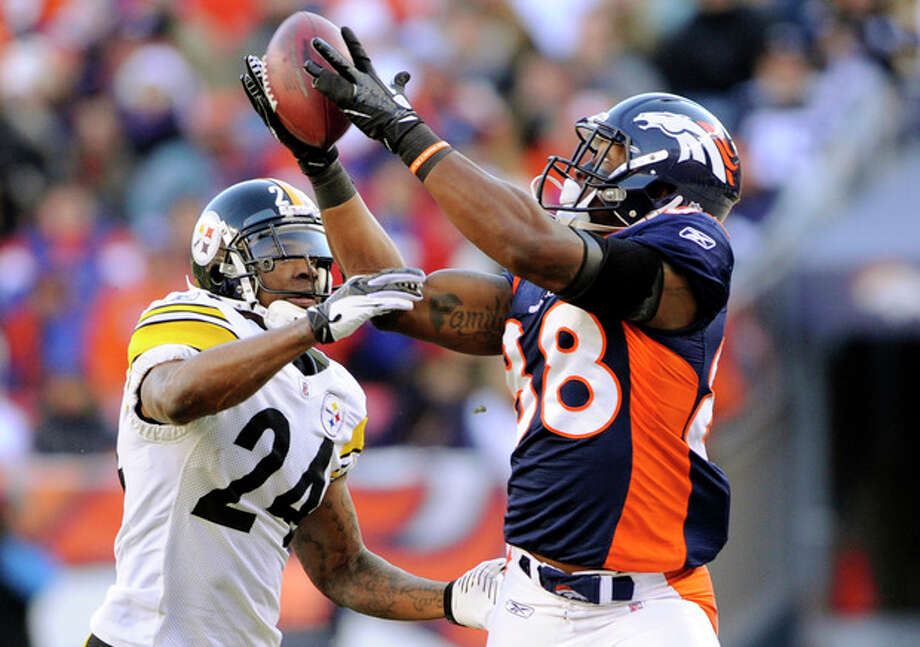 Denver Broncos wide receiver Demaryius Thomas, right, makes a 51-yard reception against Pittsburgh Steelers' Ike Taylor (24) during an NFL wild card playoff football game, Sunday, Jan. 8, 2012, in Denver. (AP Photo/The Denver Post, Hyoung Chang) MANDATORY CREDIT; MAGS OUT; TV OUT / The Denver Post