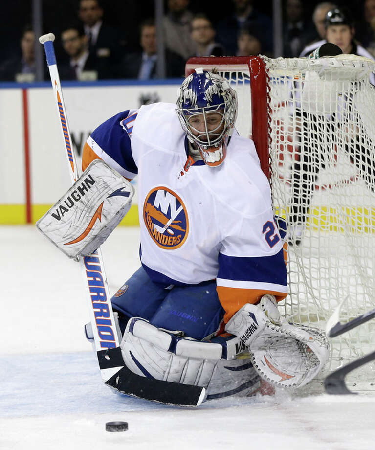 New York Islanders goalie Evgeni Nabokov defends the net during the second period of the NHL hockey game against the New York Rangers in New York, Thursday, Feb. 7, 2013. (AP Photo/Seth Wenig) / AP