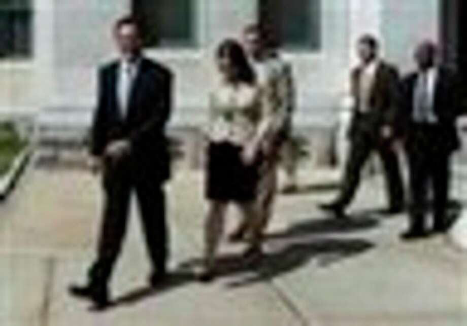 Connecticut Gov. Dannel P. Malloy, left, leaves with his staff for an event as the House and Senate are in special session at the Capitol in Hartford, Conn., Thursday, June 30, 2011. Connecticut lawmakers returned to the state Capitol on Thursday and are expected to vote on an 11th-hour, tentative compromise reached with Gov. Dannel P. Malloy on balancing the state budget after state employees rejected a labor-savings and concessions deal. (AP Photo/Jessica Hill) / AP2011