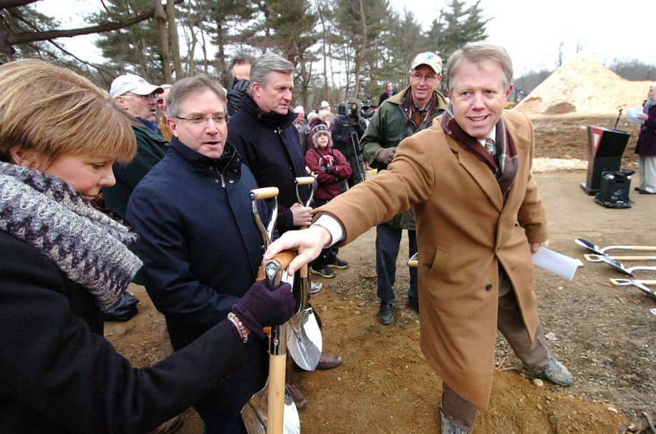 Hour Photo Alex von Kleydorff; Westport Weston Family Y CEO Rob Reeves hands out shovels for a groundbreaking ceremony at the YMCA's new site in Westport.