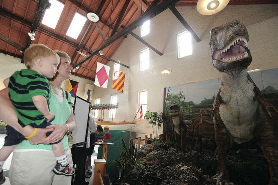 Hour photo/Matthew VinciSusan Degraff and her grandson Nicholas 2, get up close to a Tyrannosaurus Rex Thursday at the Maritime Aqaurium's Dinosaur Summer exhibit. / (C)2011, The Hour Newspapers, all rights reserved
