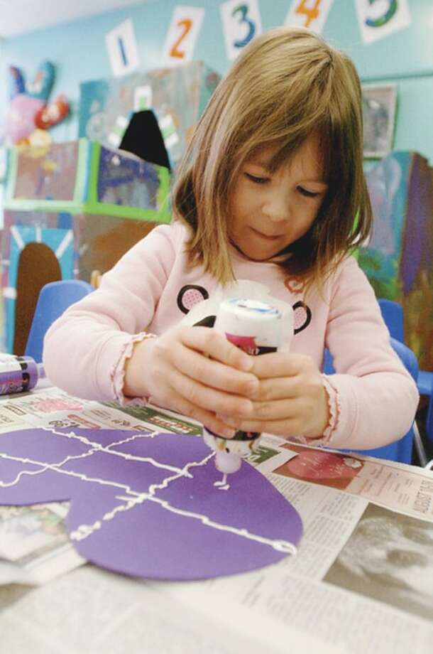 Camille Agostino, a 3 year old in Wilton Parks and Recs' On School Road program, creates art projects as part of preschool's daily activities. Hour photo / Erik Trautmann