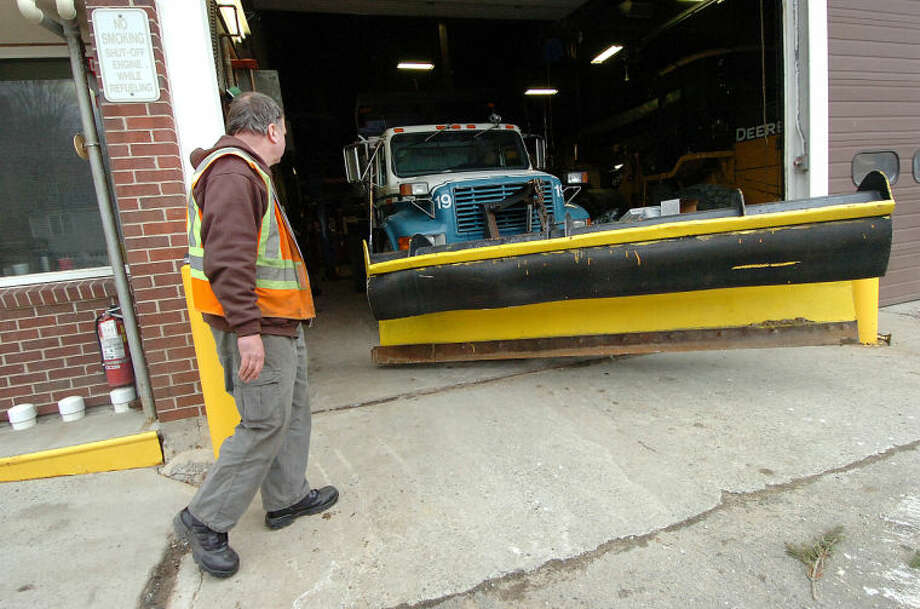 Hour Photo/ Alex von Kleydorff. Wiltons Department of Publick Works Supervisor Bob Flemming makes sure all the towns snow plows are ready to roll, after they are checked, fuled and filled with salt, he moves them into the garage overnight ready for Fridays snow