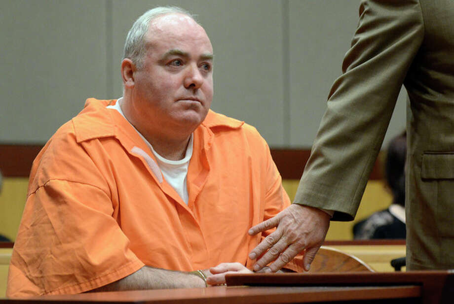 Michael Skakel, left, is hushed by his attorney Hubert Santos, right, after speaking out of turn in court in Middletown, Conn., Tuesday, Jan. 24, 2012. Skakel is seeking a reduction in his sentence of 20 years to life in prison for killing his neighbor Martha Moxley. (AP Photo/Jessica Hill, Pool) / AP2012