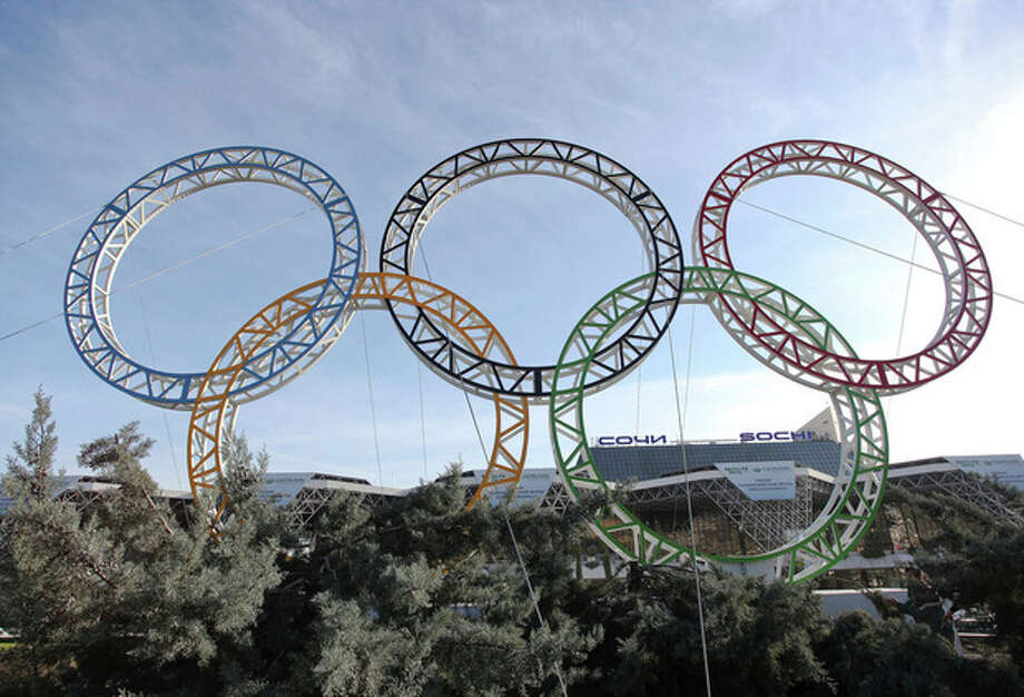Olympic rings for the 2014 Winter Olympics are installed in the Black Sea resort of Sochi, southern Russia, late Tuesday, Sept. 25, 2012. With the Winter Olympics a year away, IOC President Jacques Rogge praised Sochi organizers on Wednesday, Feb. 6, 2013 and defended the $51 billion price tag. (AP Photo/Ignat Kozlov)) / AP