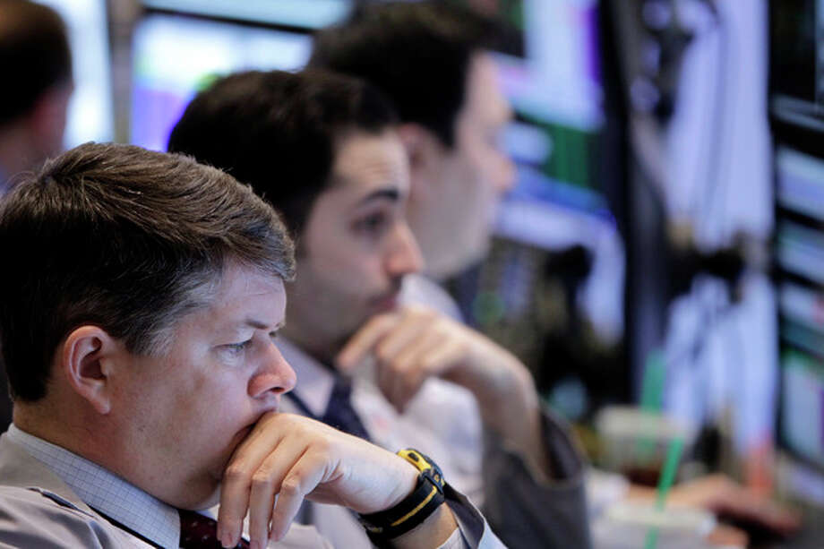 Traders work on the floor at the New York Stock Exchange in New York, Tuesday, Feb. 21, 2012. U.S. stocks are opening higher and the Dow Jones industrial average is nearing 13,000 after Greece secured a bailout deal to keep it from default. (AP Photo/Seth Wenig) / AP