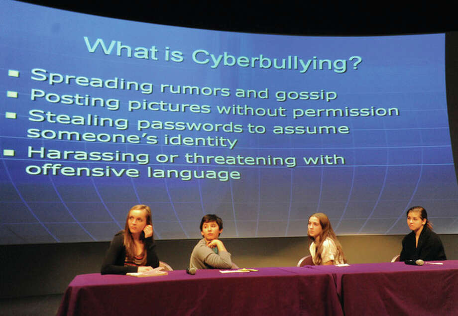 "Hour photos / Matthew Vinci Youths attend a forum for ""Internet Safety and Digital Permanence"" at Stepping Stones Museum for Children on Sunday. From left, Dakota DiMattio from Wilton High School; and Sam Rosenthal, Chloe Mandell and Melissa Lesnar, all from Weston High School. / (C)2011 {your name}, all rights reserved"