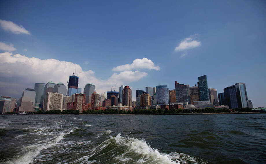Downtown Manhattan skyline is scene from the New York harbor on Friday, Aug. 26, 2011 in New York. Mayor Michael Bloomberg of New York City orders the mandatory evacuation of around 250,000 residents in Manhattan for preparation of Hurricane Irene. (AP Photo/Jin Lee) / FR159730 AP