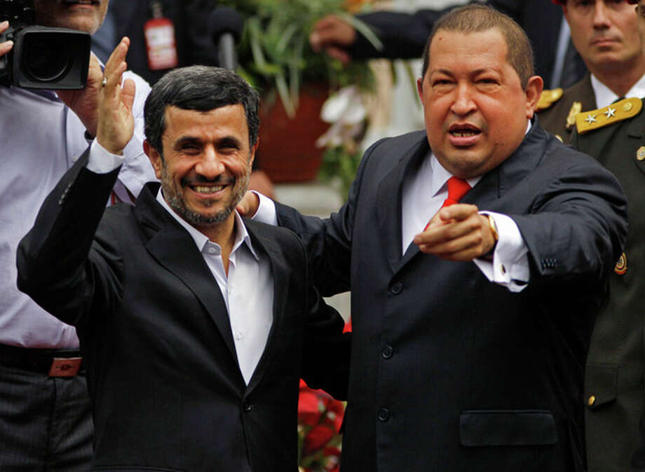 AP Photo/Ariana Cubillos Iran's President Mahmoud Ahmadinejad, left, is received by Venezuela's President Hugo Chavez at the Miraflores presidential palace in Caracas, Venezuela, Monday. / AP