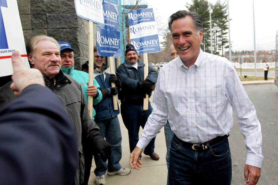 Republican presidential candidate former Massachusetts Gov. Mitt Romney arrives at a Boys and Girls Club, Thursday, Jan. 5, 2012, in Salem, N.H. (AP Photo/Matt Rourke) / AP