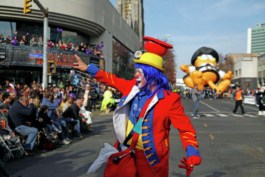 Clown Charles Bia preforms a trick with glitter during the annual UBS Parade Spectacular in Stamford Sunday afternoon. Hour Photo / Danielle Robinson