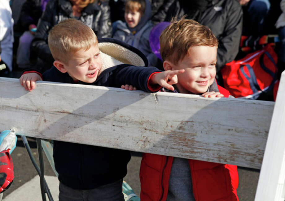 @Cutline:At left: Liam Pufko, 5, and Harrison Mirkin, 5, watch the parade.