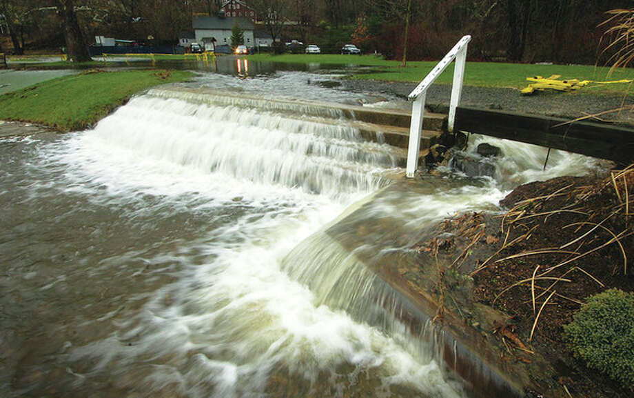 File Photo/Alex von Kleydorff. In this 2010 photo, water from the Comstock Brook flows over a set of stairs that normally lead to the pond at Merwin Meadows park in Wilton.