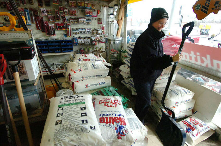 Hour Photo/ Alex von Kleydorff. Kathy Anderson buys a snow shovel at Carlyn hardware on Westport Ave. Business was brisk with area residents preparing for a snow storm and are buying everything thats emergency related. Snow shovels, fireplace wood, gas cans and generators and salt were some of the fast selling items