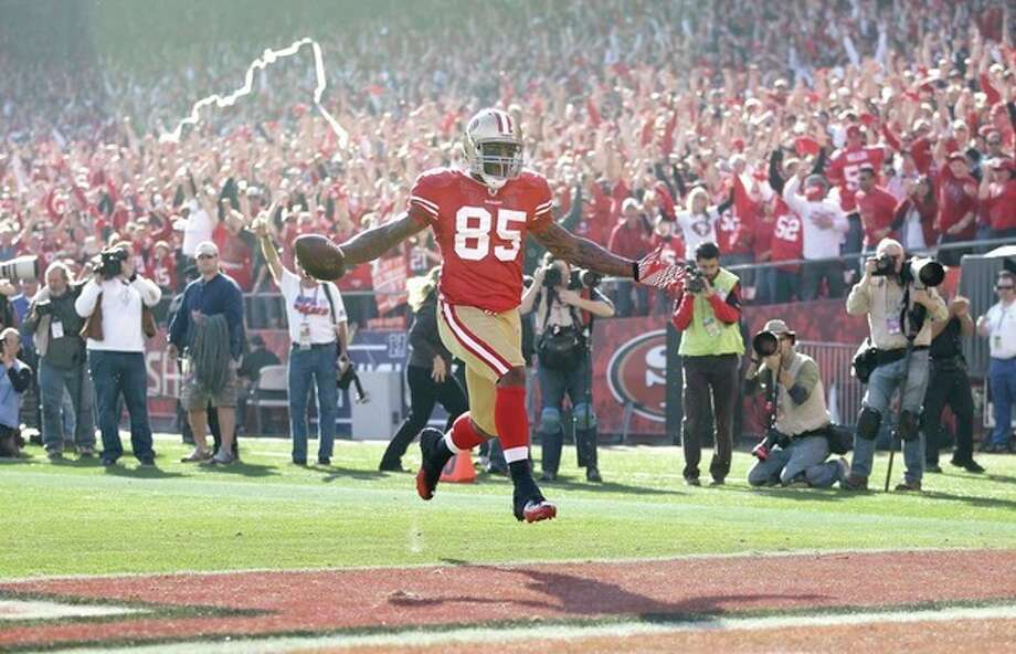 San Francisco 49ers tight end Vernon Davis (85) celebrates after scoring on a 49-yard touchdown reception during the first quarter of an NFL divisional playoff football game against the New Orleans Saints on Saturday, Jan. 14, 2012, in San Francisco. (AP Photo/Paul Sakuma) / AP