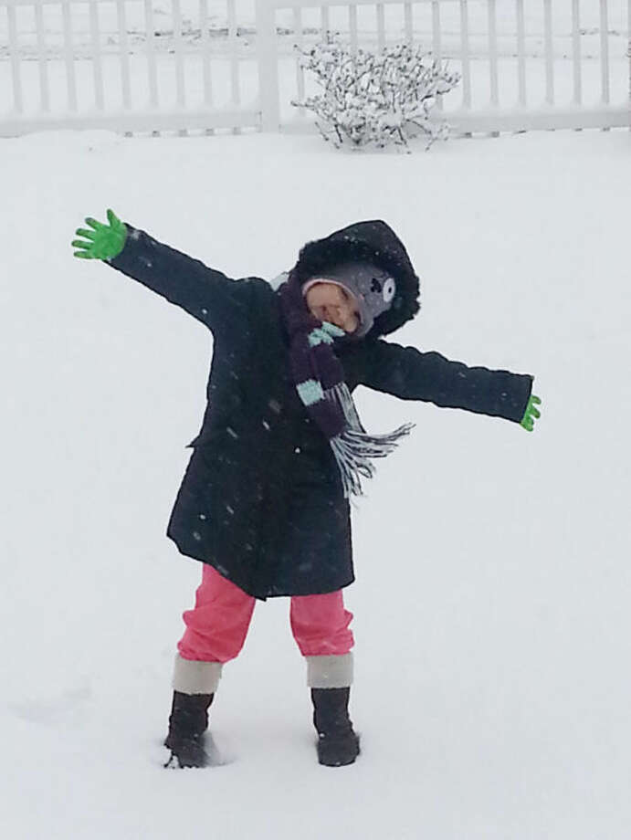 Kayle excited about the snow storm in Norwalk on Friday.