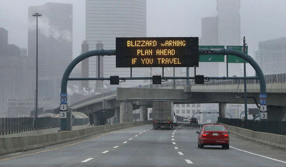 A warning sign flashes for motorists on the expressway into Boston as snow starts to fall on Friday, Feb. 8, 2013. A major winter storm is heading toward the U.S. Northeast with up to 2 feet of snow expected for a Boston-area region that has seen mostly bare ground this winter. (AP Photo/Elise Amendola) / AP