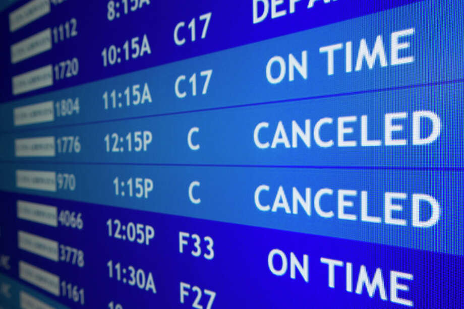 Two flights to Boston are listed as canceled at Philadelphia International Airport, Friday, Feb. 8, 2013, in Philadelphia. Airlines have already canceled more than 2,700 Friday flights as they get ready for a storm that threatens to dump up to 3 feet of snow from New York City to Boston. Flight-tracking website FlightAware shows 728 cancellations at the three big airports in the New York area. Another 191 flights to or from Boston have been scrubbed, and 137 in Toronto. (AP Photo/Matt Rourke) / AP