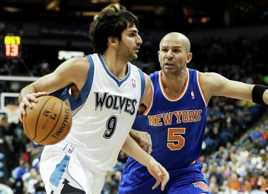 Minnesota Timberwolves' Ricky Rubio of Spain, left, drives around New York Knicks' Jason Kidd in the first period of an NBA basketball game Friday, Feb. 8, 2013 in Minneapolis. (AP Photo/Jim Mone) / AP