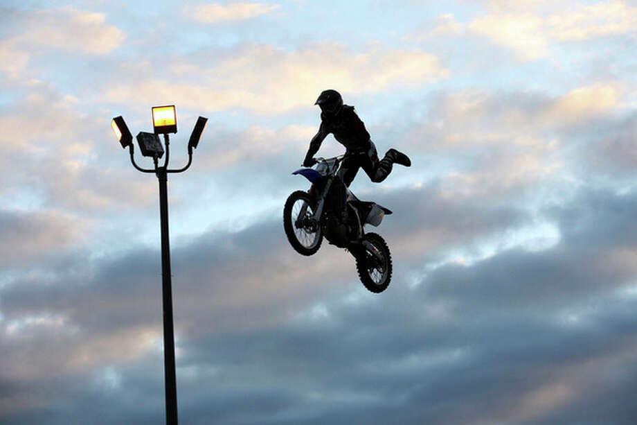 A Motorcrosser preforms for an audience during the Oyster Festival in 2010. Hour Photo / Danielle Robinson