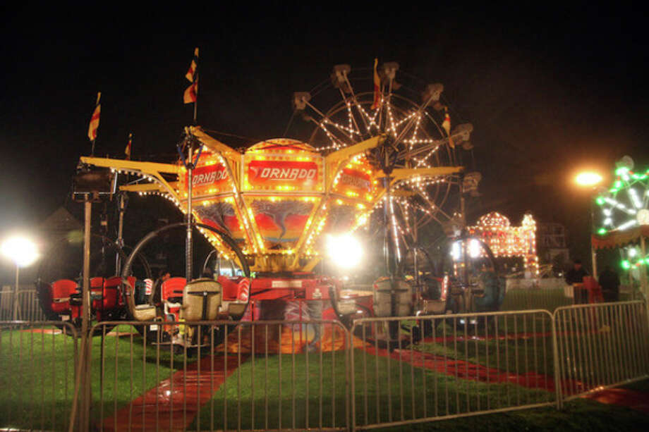 Oyster Festival Rides were empty Friday evening due to rain in 2009. Hour Photo / Danielle Robinson