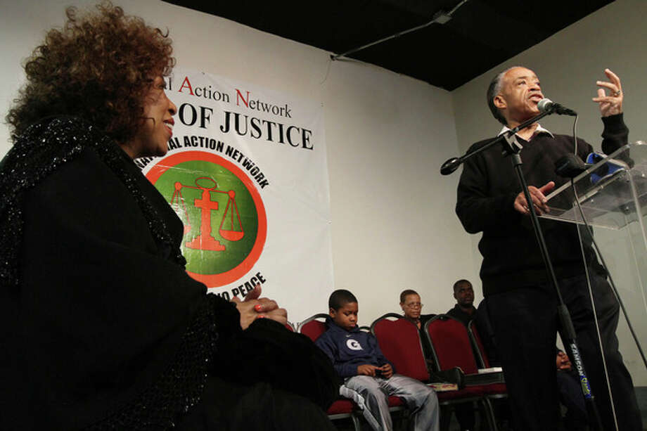 """Singer Roberta Flack, left, and others listens as Rev. Al Sharpton, right, speaks during a tribute to """"Soul Train"""" creator Don Cornelius at Sharpton's National Action Network in New York Saturday, Feb. 4, 2012. Cornelius died this week at his Los Angeles home of a self-inflicted gunshot wound. He was 75. (AP Photo/Tina Fineberg) / FR73987 AP"""