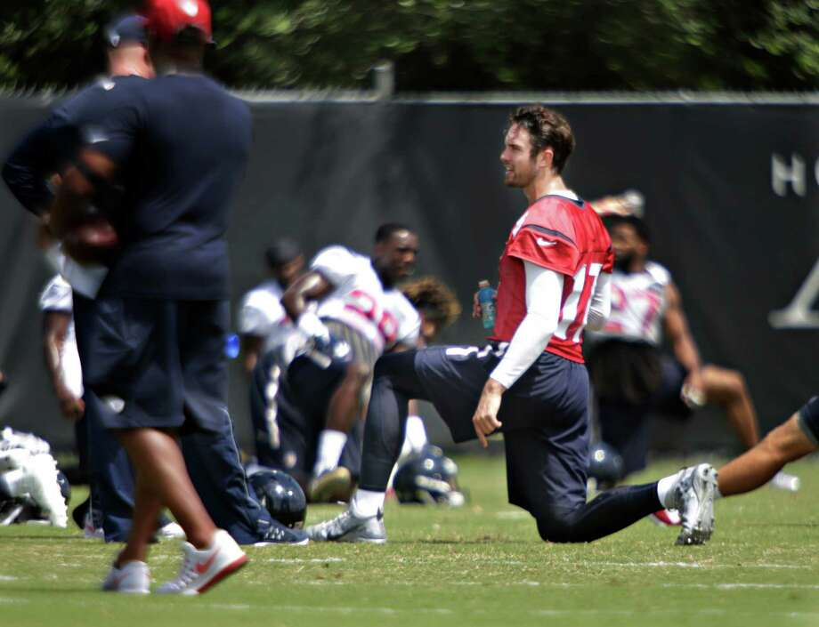 Texans quarterback Brock Osweiler stretches during mini camp at the Texans practice facility at NRG Stadium, Tuesday, June 14, 2016, in Houston. Photo: Houston Chronicle / © 2016 Houston Chronicle