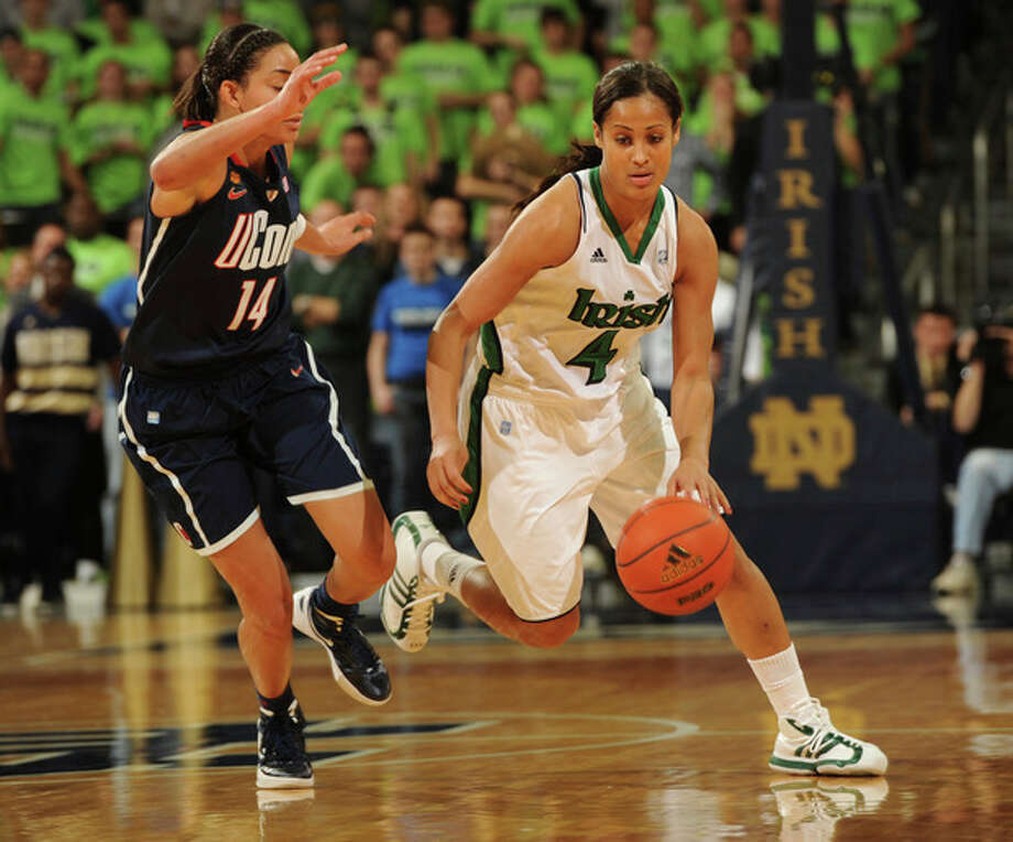 AP photo Notre Dame guard Skylar Diggins, right, heads upcourt as Connecticut guard Bria Hartley defends during the second half of Saturday's showdown in South Bend, Ind. The third-ranked Irish came back from an eight-point deficit to down No. 2 UConn, 74-67, in overtime. Diggins had 22 points in the game and Hartley scord a hame-high 25. / Joe R. Raymond