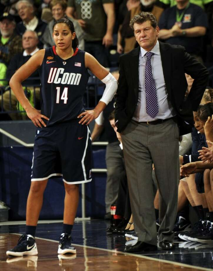 Connecticut guard Bria Hartley, left, stands with coach Geno Auriemma in the closing minutes of the second half of an NCAA college basketball game against Notre Dame, Saturday, Jan. 7, 2012, in South Bend, Ind. Connecticut loss 74-67 in overtime. (AP Photo/Joe Raymond)