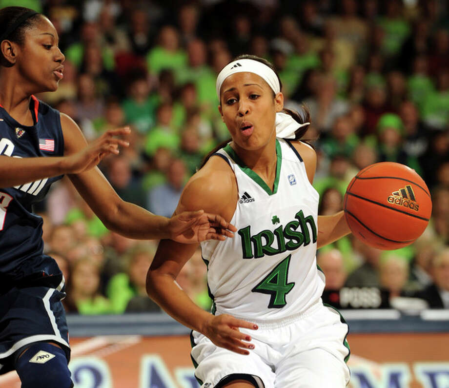 Notre Dame guard Skylar Diggins, right, drives the lane as Connecticut guard Tiffany Hayes defends during the first half of an NCAA college basketball game , Saturday, Jan. 7, 2012, in South Bend, Ind. (AP Photo/Joe Raymond) / Joe R. Raymond