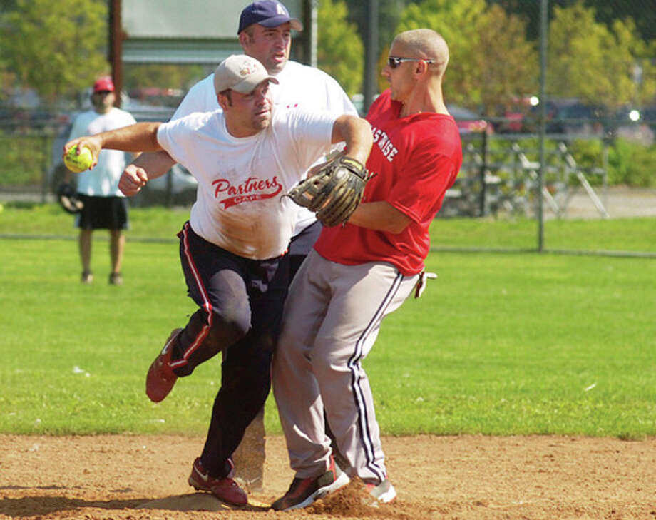 Partners Cafe's Franco Iannone tries make a double play against Coastwise Marina's Mike Mastronardi while 2nd basman Ryan Karwowski backs up the play during the 3rd annual Click it for Cassie Foundation Softball Tournament Saturday. / (C)2011, The Hour Newspapers, all rights reserved